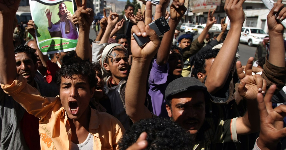 Anti-regime demonstrators rally in Sanaa against the law of immunity approved yesterday by Yemen's parliament.</p>