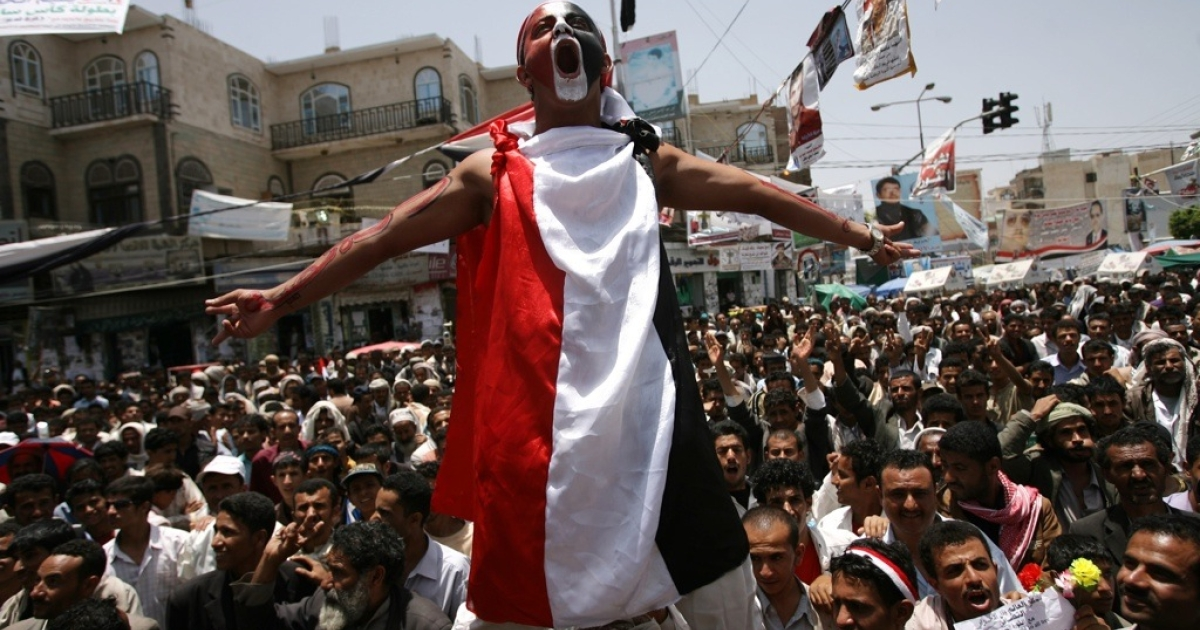 Anti-government protesters shout slogans during a demonstration demanding the resignation of Yemeni President Ali Abdullah Saleh in Sanaa on May 14, 2011.</p>
