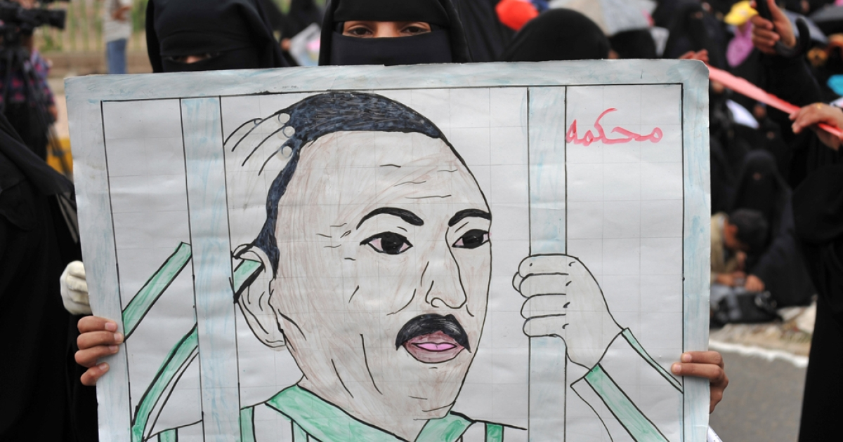 A Yemeni anti-government protester holds a drawing calling for the trial of President Ali Abdullah Saleh during a demonstration in Sanaa. Now Saleh says he will step down.</p>