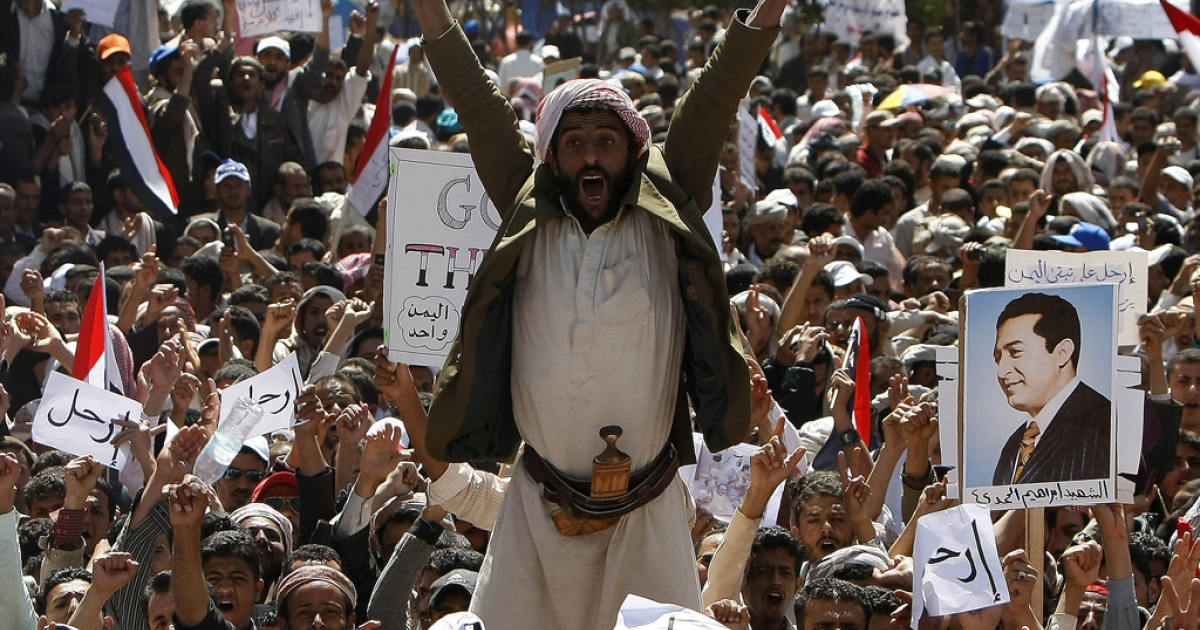 Yemeni protesters chant slogans calling for the ouster of President Ali Abdullah Saleh during a massive anti-regime rally in the capital Sanaa on March 1, 2011.</p>