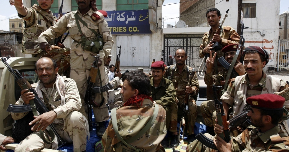Yemeni soldiers who joined sides with anti-regime protesters flash the V-sign for victory during a demonstration calling for the ouster of President Ali Abdullah Saleh in Sanaa on June 3, 2011.</p>