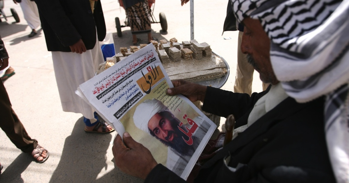 An anti-government protester in Yemen reads a daily Arabic newspaper fronted with an image reporting the killing of Al Qaeda leader Osama bin Laden in the capital Sanaa on May 3, 2011.</p>