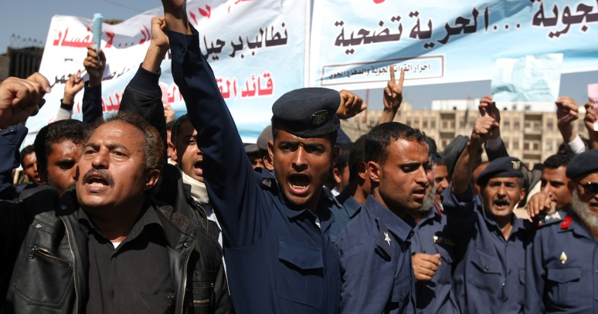 Members and officers of the Yemeni Air Force protest outside the residence of Vice President Abd Rabbo Mansur Hadi, as they call for the dismisal of Air Force commander Major General Mohammed Saleh, the half-brother of outgoing Yemeni President Ali Abdullah Saleh, in Sanaa on January 23, 2012.</p>