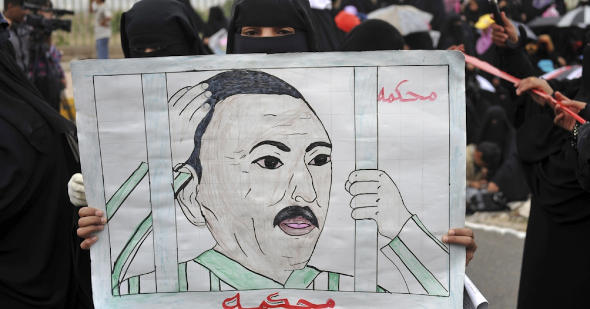 A Yemeni anti-government protester holds a drawing calling for the trial of President Ali Abdullah Saleh during a demonstration in Sanaa. On October 8, 2011, President Salah said he would give up power in the coming days.</p>