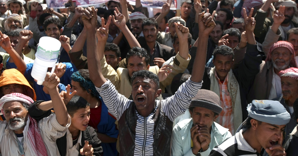 Yemeni  protesters shout slogans during a demonstration against the law of immunity pertaining outgoing President  Ali Abdullah Saleh for the transfer of power after the upcoming February presidential elections, in Sanaa on January 9, 2012, as Yemen's Prime Minister Mohammed Basindawa began a tour to the country's oil-rich Gulf neighbours to seek urgently needed aid for an economy approaching collapse.   AFP PHOTO/ MOHAMMED HUWAIS</p>