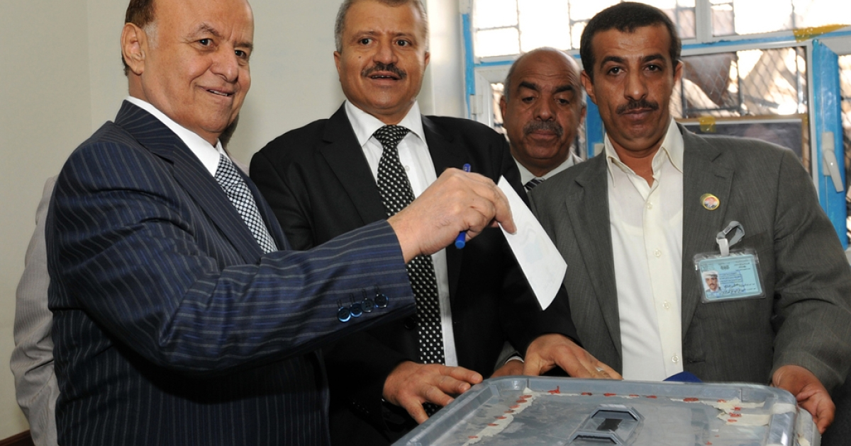 Yemen's Vice President and the sole presidential candidate, Abdrabuh Mansur Hadi (L), casts his ballot at a polling station in Sanaa on February 21, 2012 as the country votes in the presidential election that brings an end to President Ali Abdullah Saleh's 33-year hardline rule in Yemen, the first Arab state where a revolt ended in a negotiated settlement. AFP PHOTO/STR</p>