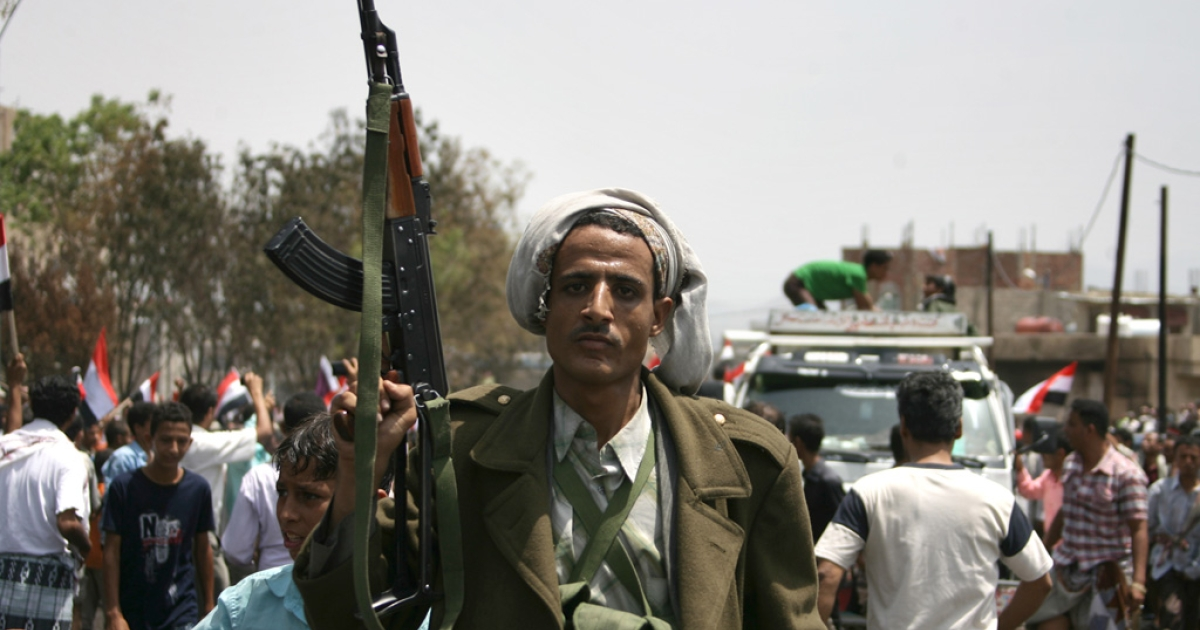 An armed tribesman in Yemen's second-largest city Taiz. Since August, some 1,000 tribesman loyal to the Sanaa government have been fighting against militants from Al Qaeda in the Arabian Peninsular, which US officials deem to be the most serious Al Qaeda threat to US security. (MOHAMMED HUWAIS/AFP/Getty Images)</p>