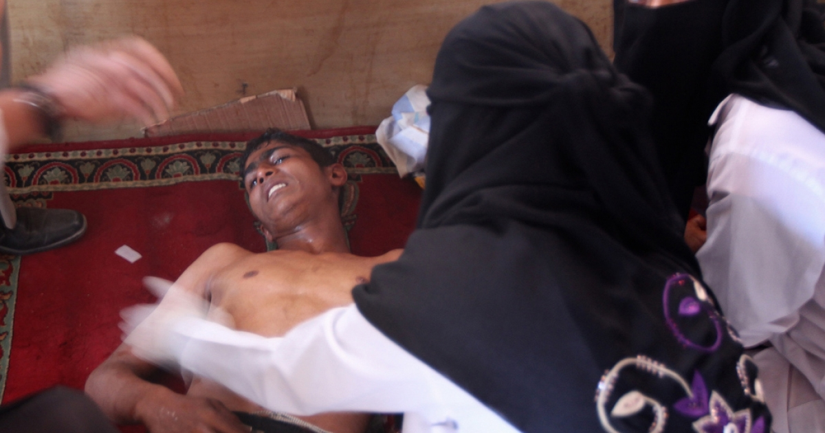 A Yemeni boy suffering from the effects of tear gas is comforted by a relative upon his arrival for treatment at a makeshift hospital in Sanaa during clashes between government forces with pro-democracy demonstartors who were demanding the ouster of President Ali Abdullah Saleh on October 16, 2011.(MARWAN NAAMANI/AFP/Getty Images)</p>