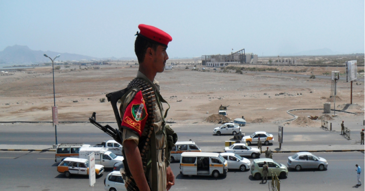Yemeni security forces secure a main road in the southern port of Aden following the seizure of Saudi Arabia's deputy consul by unknown gunmen outside his home in the southern city on March 28, 2012.</p>