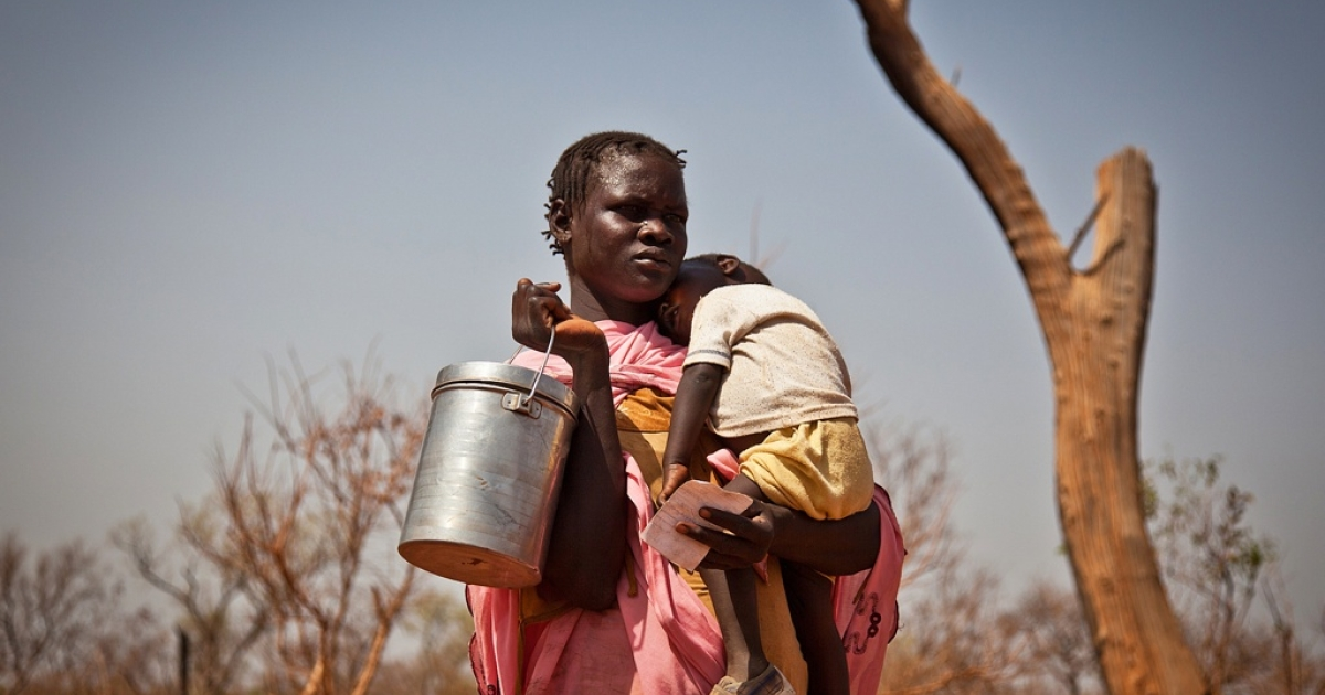 Domestic violence is often a serious threat to women refugees in Africa, according to a new report by the International Rescue Committee. Here a displaced woman and her child from the Nuba Mountains in Sudan wait outside the Yida refugee camp registration center in Yida, South Sudan on April 26, 2012.</p>