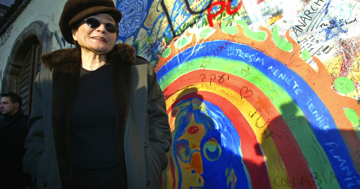 Yoko Ono, John Lennon's widow, in front of the memorial wall dedicated to him in Prague.</p>