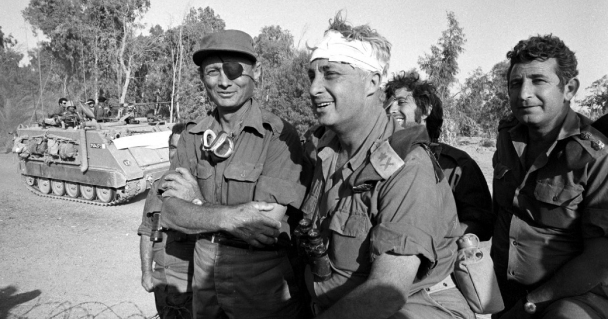 Israeli army Southern Command General Ariel Sharon with Defense Minister Moshe Dayan during the Yom Kippur War in October 1973 on the western bank of the Suez Canal in Egypt.</p>
