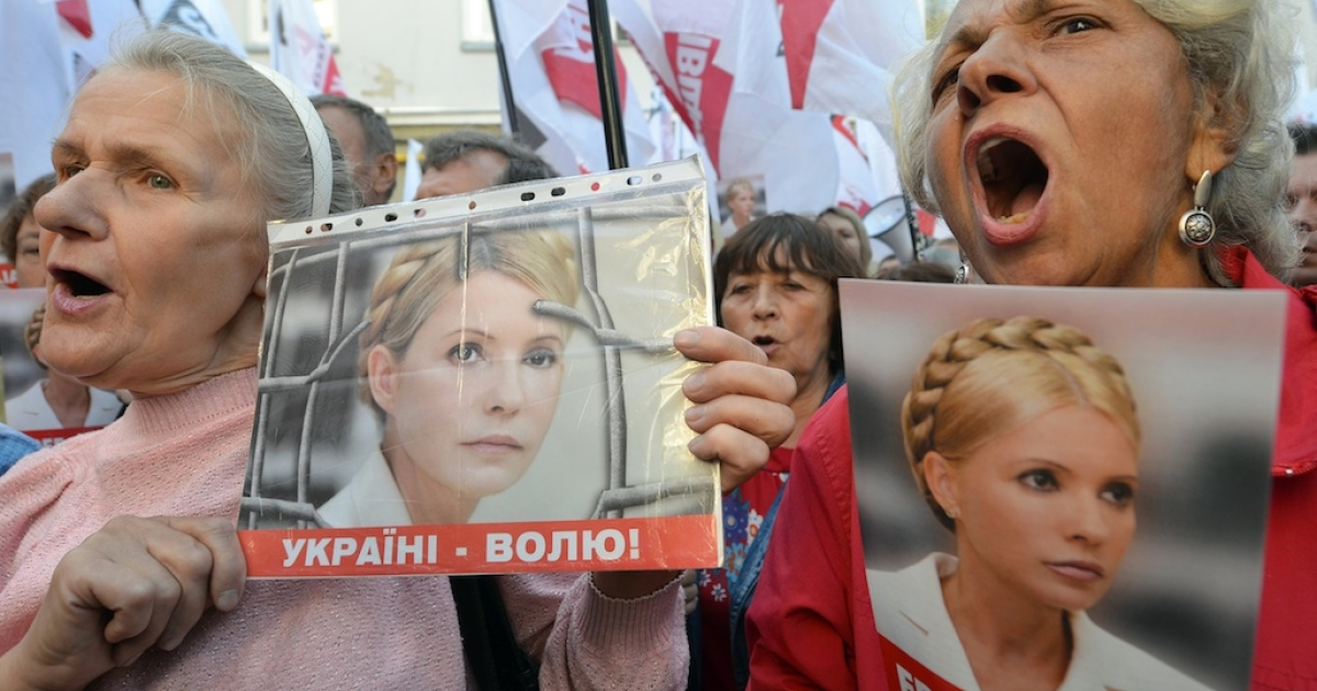 Supporters of former Ukrainian Prime Minister Yulia Tymoshenko chant slogans during a protest in front of Kiev's High Court on August 21, 2012, during a session of hearings on an appeal against her conviction and seven-year jail sentence for abuse of office while prime minister.</p>