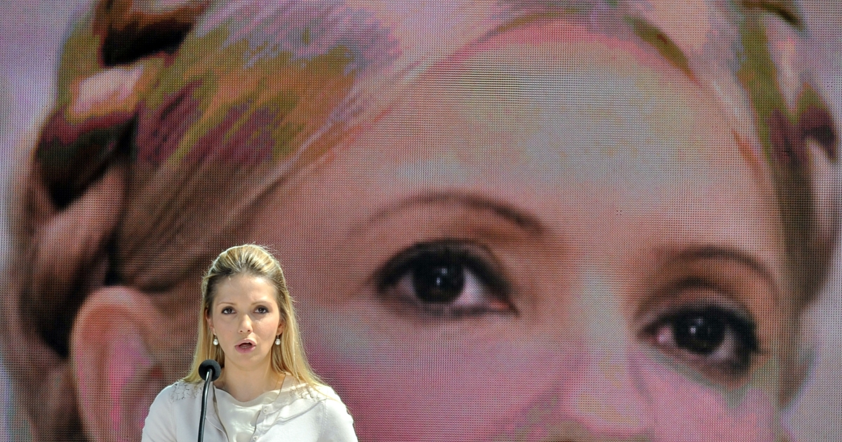 The daughter of Ukraine's jailed former Prime Minister Yulia Tymoshenko, Yevgenia Tymoshenko, reads a letter from her mother in front of giant screen displaying a picture of the opposition leader on May 12, 2012 during an anti-government protest in Kiev. Tymoshenko, who suffers from debilitating back pain, was moved from jail to a hospital in Ukraine's second city Kharkiv on May 9. She had accused prison guards of beating her and released photos of her bruises.</p>