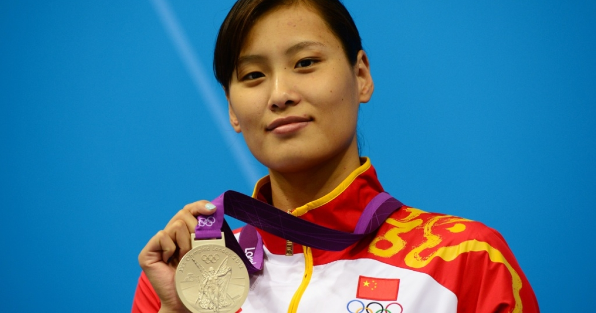 China's silver medalist Lu Ying poses on the podium after the women's 100m butterfly final swimming event at the London 2012 Olympic Games on July 29, 2012 in London.</p>