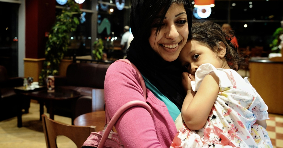 Bahraini opposition activist Zainab al-Khawaja, daughter of prominent jailed opponent Abdulhadi al-Khawaja, holds her daughter Jude as they sit in a coffee shop in the village of Abu Saiba.</p>