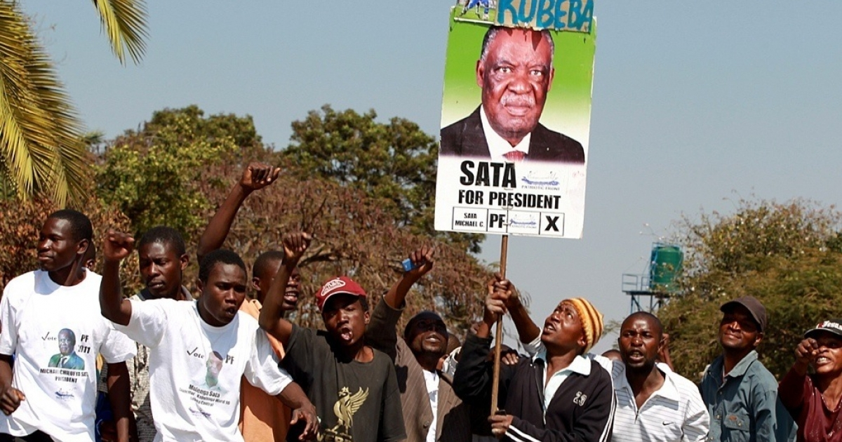 Supporters of Zambia's opposition Patriotic Front leader Michael Sata demonstrate on August 9, 2011 outside the high court of Lusaka where Sata filed his nomination ahead presidential elections.</p>
