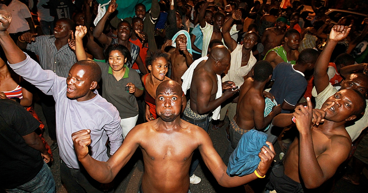 Zambians celebrate in Lusaka early on September 23, 2011, after Michal Sata was declared winner of Zambia's President election. Sata, the populist leader of Zambia's opposition, was declared the country's next president, after a tense election marred by outbursts of violence that left two people dead.</p>