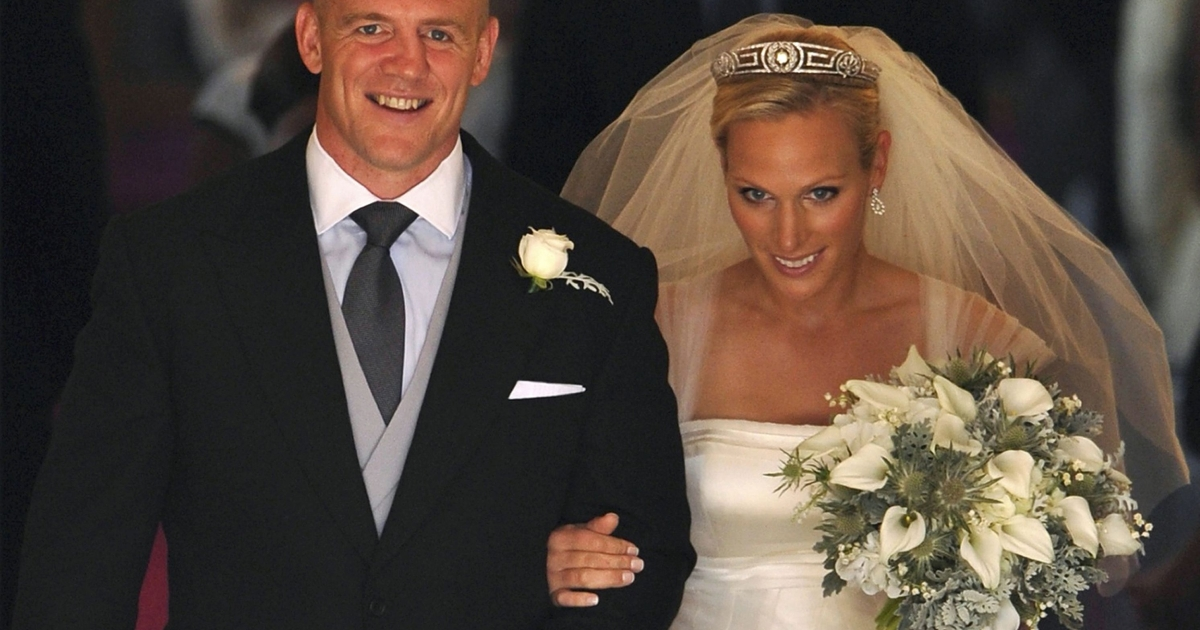 Britain's Zara Phillips, granddaughter of Queen Elizabeth II, and her new husband English rugby player Mike Tindall leave after their wedding ceremony at Canongate Kirk in Edinburgh, Scotland, on July 30, 2011.</p>