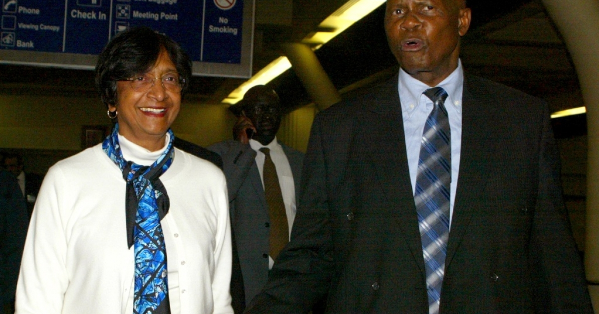 The UN High Commissioner for Human Rights Navi Pillay, left, is welcomed by Zimbabwe Justice Minister Patrick Chinamasa upon arrival in Harare on May 20, 2012 for a five day visit to asses the human rights situation in Zimbabwe.</p>