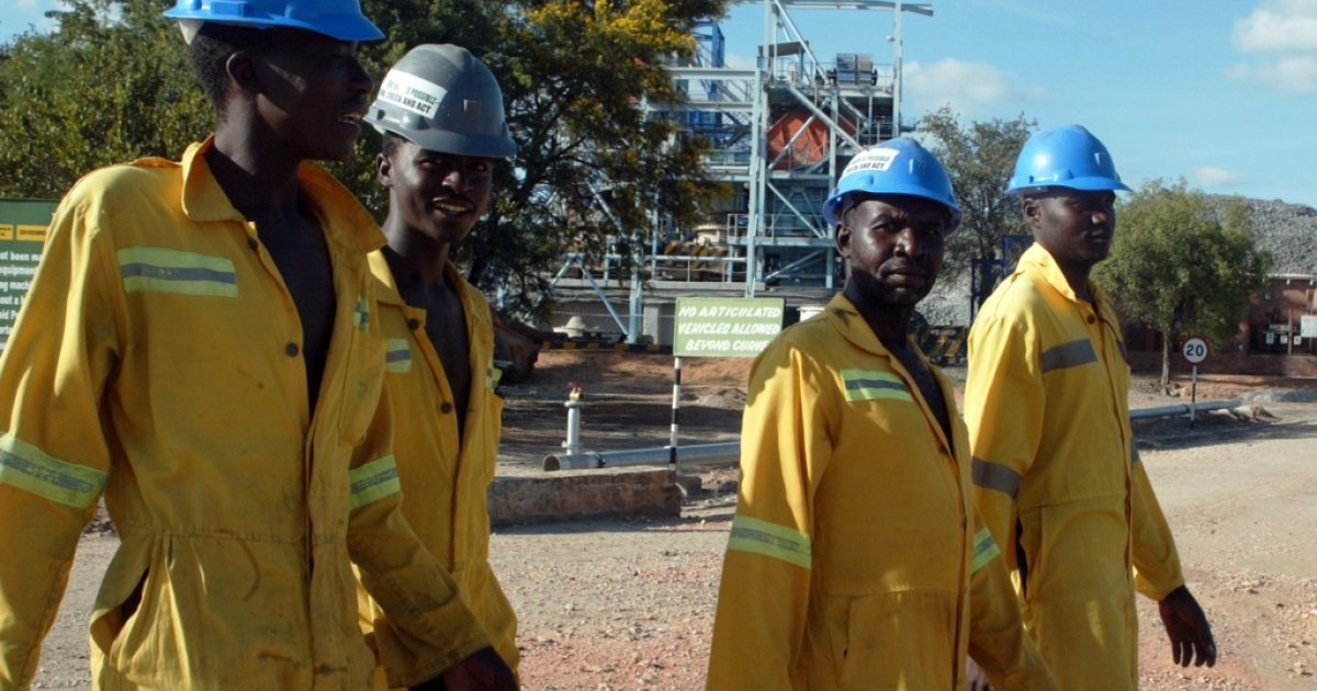 Workers at the Mimosa Mine in Zvishavane, on February 16, 2012. 65 miners were rescued after being trapped in the Mimosa mine for nearly 24 hours.</p>