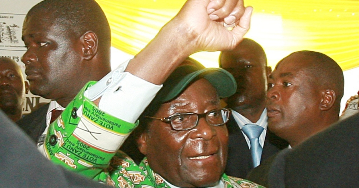 Zimbabwe's President Robert Mugabe gives his trademark clenched fist salute. Mugabe said if America, Britain and the European Union maintain personal sanctions against him and his supporters, his regime will seize Western-owned firms operating in Zimbabwe.</p>