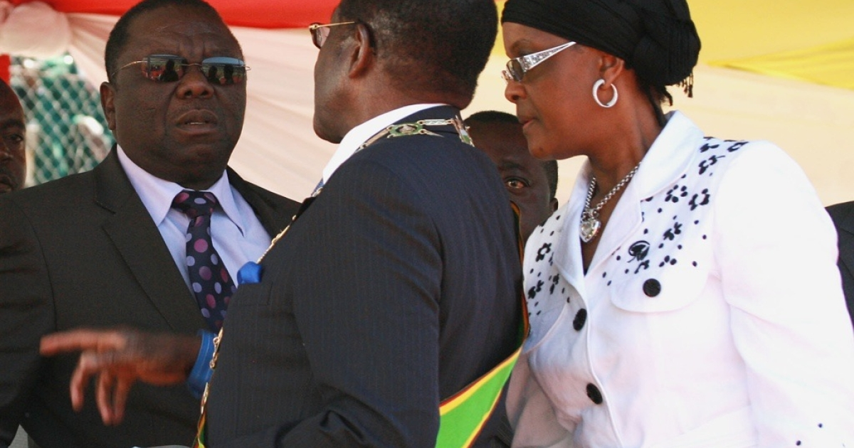 Zimbabwean President Robert Mugabe, center, and his wife Grace, right, chat with Prime Minister Morgan Tsvangirai, left, at the National Sports Stadium in Harare.</p>