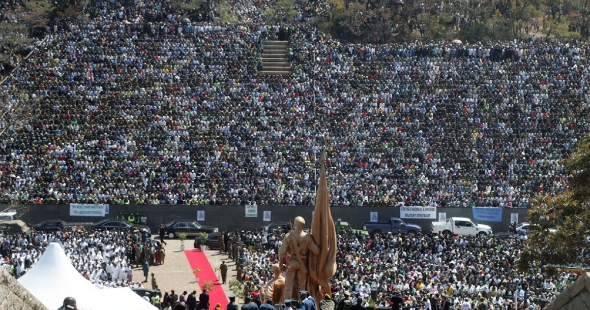 Thousands of mourners gather at Zimbabwe's National Heroes Acre for the burial of Solomon Mujuru, the country's first defence chief and husband of Vice President Joice Mujuru on August 20, 2011 in Harare. Zimbabwean President Robert Mugabe urged the country's political rivals to stop any violence ahead of elections. Mugabe also used the funeral to lash out at familiar targets of western countries and gays.</p>