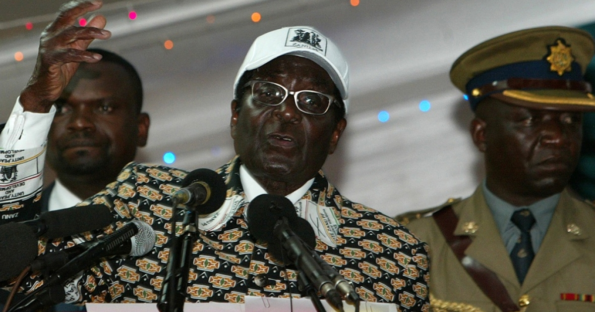 Zimbabwe's President and leader of ZANU-PF Robert Mugabe calls for elections in 2012 at the party's annual conference in Bulawayo, on December 10, 2011. Mugabe said he has no intention of retiring, saying doing so would be an act of 'cowardice.'</p>