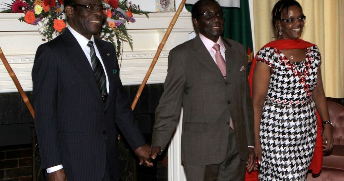 Zimbabwe President Robert Mugabe (C) together with the first lady Grace Mugabe (R) greets the Equitorial Guinea's President Teodoro Obiang Nguema (L) upon his arrival at the Zimbabwe State House in Harare on Janaury 9, 2012. Africa's longest-ruling leader, Equatorial Guinea's Teodoro Obiang Nguema, on Monday made an unannounced visit to Zimbabwe and pleged to increase cooperation between the two countries.</p>