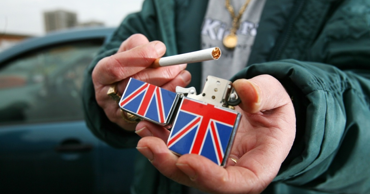 A woman holds a Zippo lighter for sale at Wimbledon car boot sale and market in London, UK, on Feb. 15, 2009.</p>
