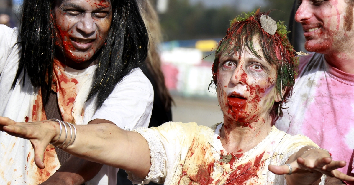 People take part in a Zombie Walk event in Bordeaux, western France, on Oct. 29, 2011.</p>