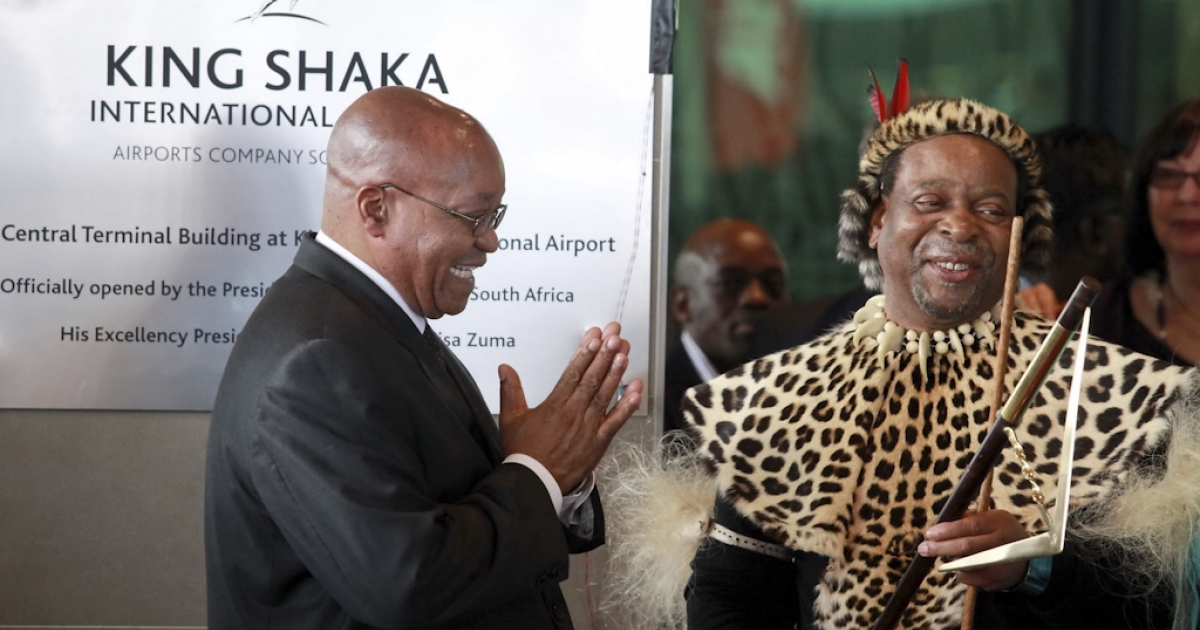South African President Jacob Zuma (L) applauds Zulu King Goodwill Zwelithini (R) after officially opening the Central Terminal building of Durban's new King Shaka International Airport and Dube Trade Port, north of Durban, South Africa.</p>