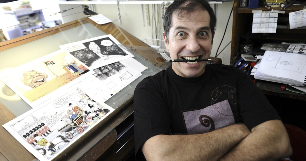The political cartoonist Jonathan Shapiro, better known as Zapiro, is pictured at his home in Cape Town. South Africa's President Jacob Zuma has dropped a case against the editor of the Sunday Times in Johannesburg and Jonathan Shapiro, a controversial cartoonist, over a cartoon that showed him unzipping his pants to rape a blindfolded Lady Justice figure in 2008.</p>