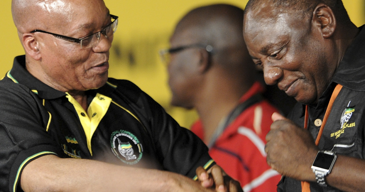 Jacob Zuma, president of South Africa and the newly re-elected African National Congress (ANC) president, congratulates businessman Cyril Ramaphosa for being elected deputy president of the party, setting him up to become Zuma's potential eventual successor, during the 53rd National Conference of the ANC on December 18, 2012 in Bloemfontein.</p>