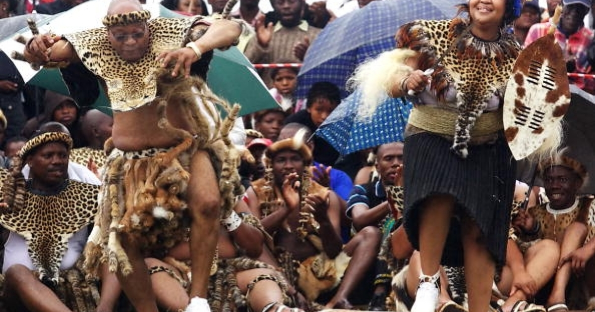 South African President Jacob Zuma (L) sings and dances with his newlywed Tobeka Madiba (R) at their wedding ceremony on January 4, 2010 in a colourful Zulu traditional wedding outfit at Zuma's rural homestead of Nkandla, some 400 kilometres north of Durban. Wearing leopard skins and carrying a Zulu shield, South Africa's polygamous President Jacob Zuma on married today for fifth time, in a traditional ceremony in his remote hometown. The 67-year-old and his new bride Thobeka Madiba, 30 years his junior, danced in an open field at his homestead in Nkandla, a village deep in the countryside of KwaZulu-Natal province.</p>