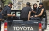 Rebels operating under the Free Syrian Army sit in a Hilux pickup truck