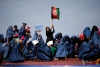 Supporters of then-Afghan presidential candidate Ashraf Ghani Ahmadzai attend an election campaign in Kunduz province, northern Afghanistan March 19, 2014. Now president, Ghani and First Lady Rula Ghani are outspoken supporters of women's rights.