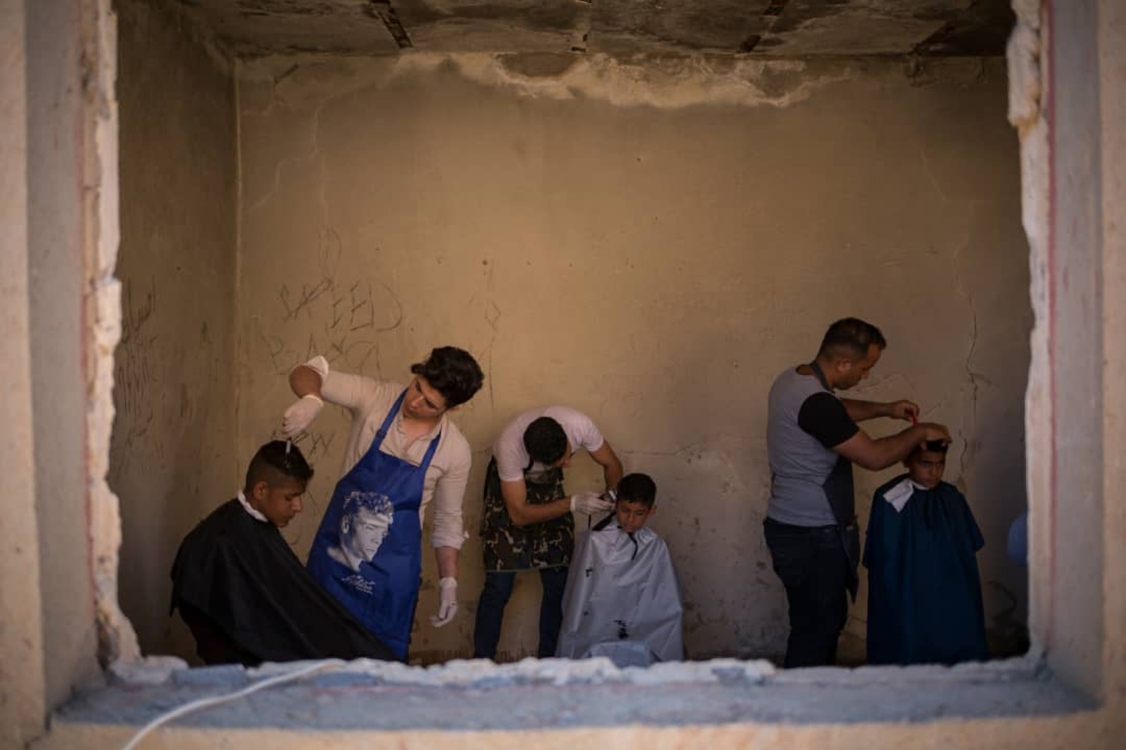 Young volunteers give free haircuts to survivors offloods in Khuzestan province in Western Iran.