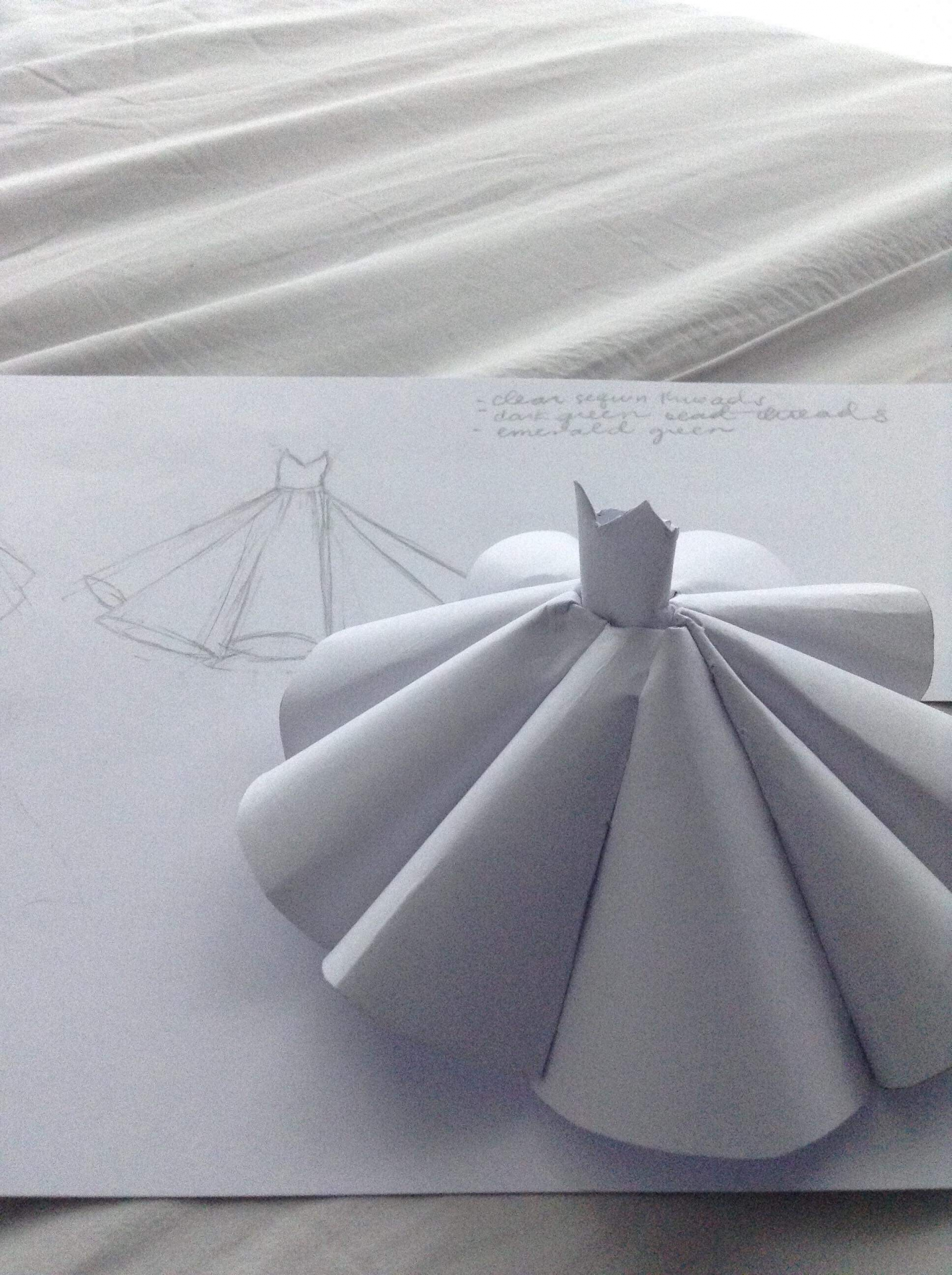 model of a gown made of white paper.