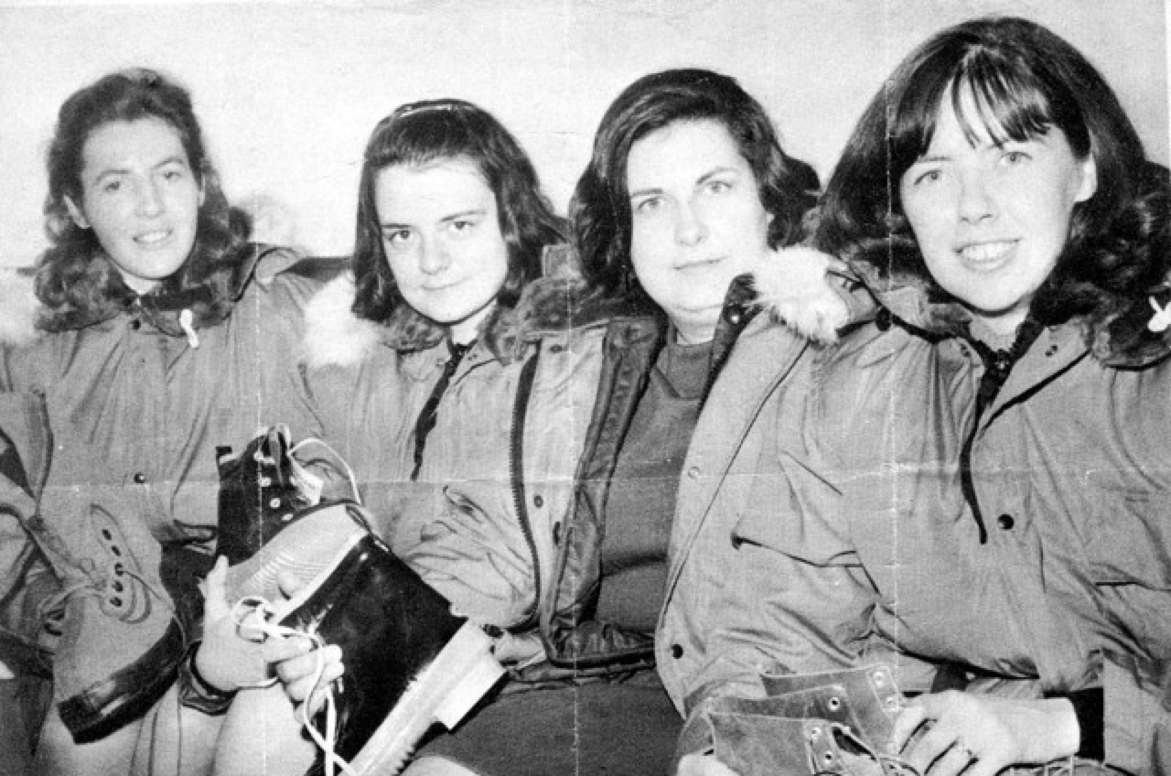 Four women pose for a photo in winter gear.