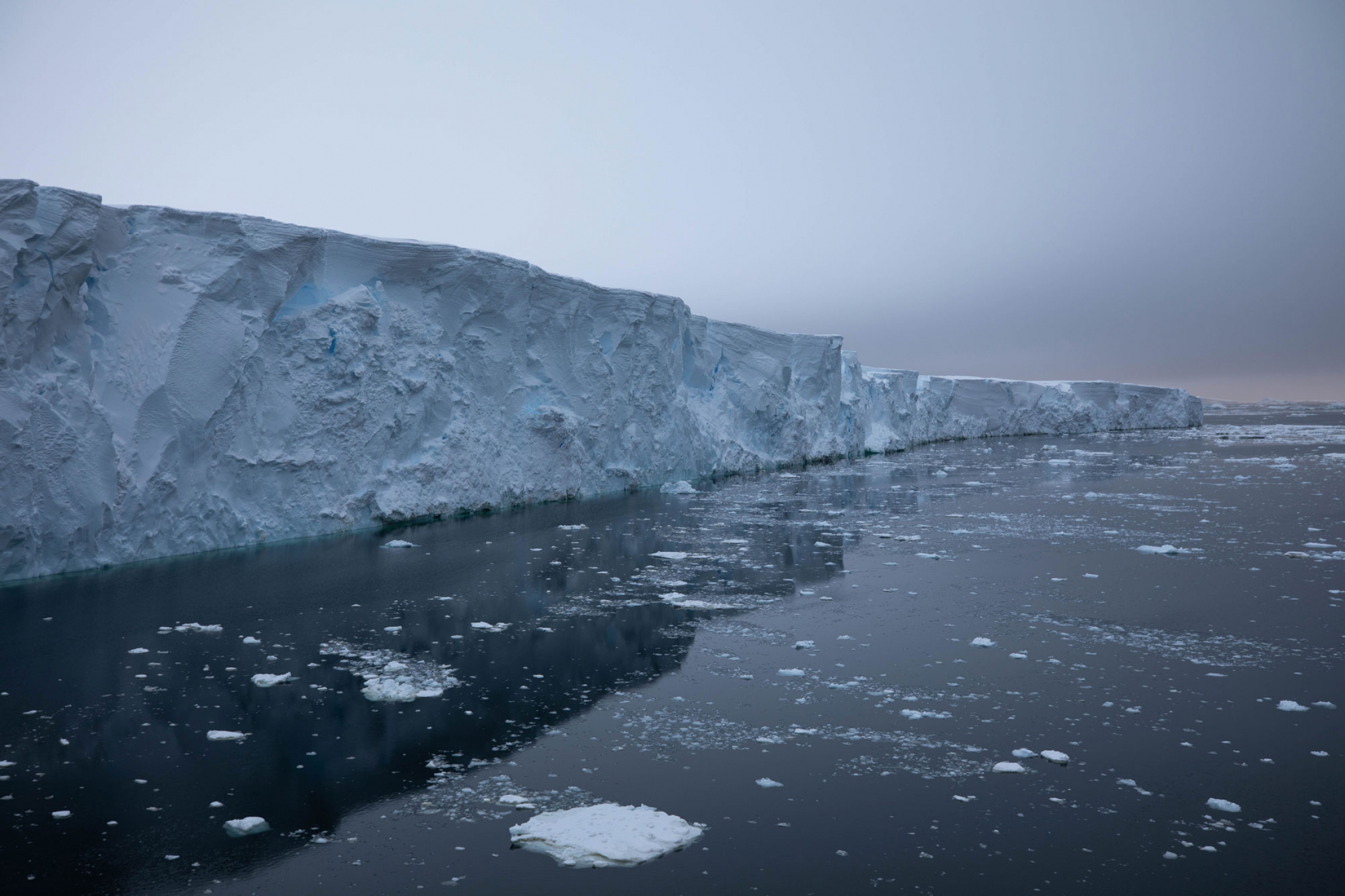 Layers of snow are shown along the edge of Thwaites Glacier