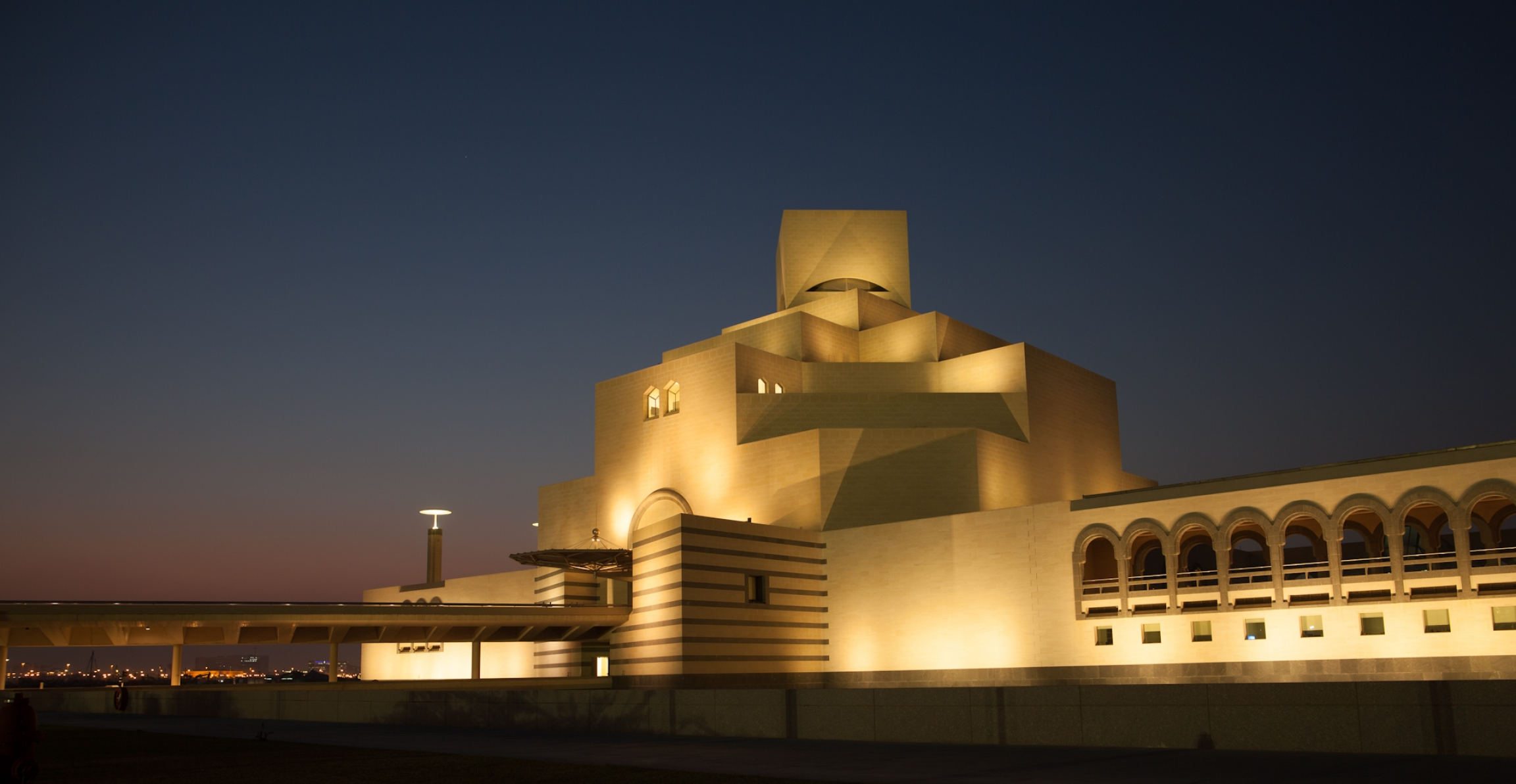 A nighttime view of the Museum of Islamic Art.