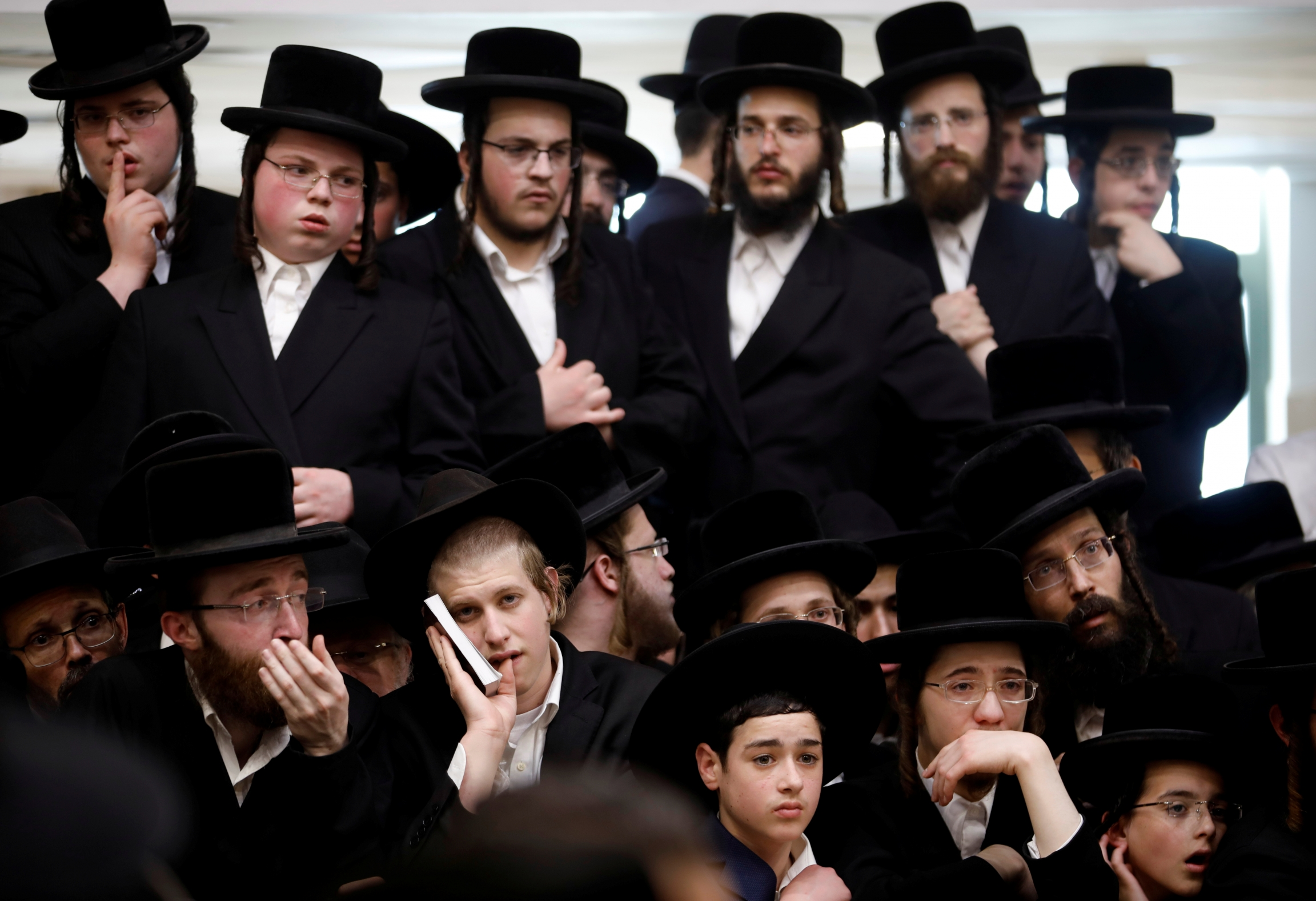 A large group of men in Orthodox Jewish clothing.