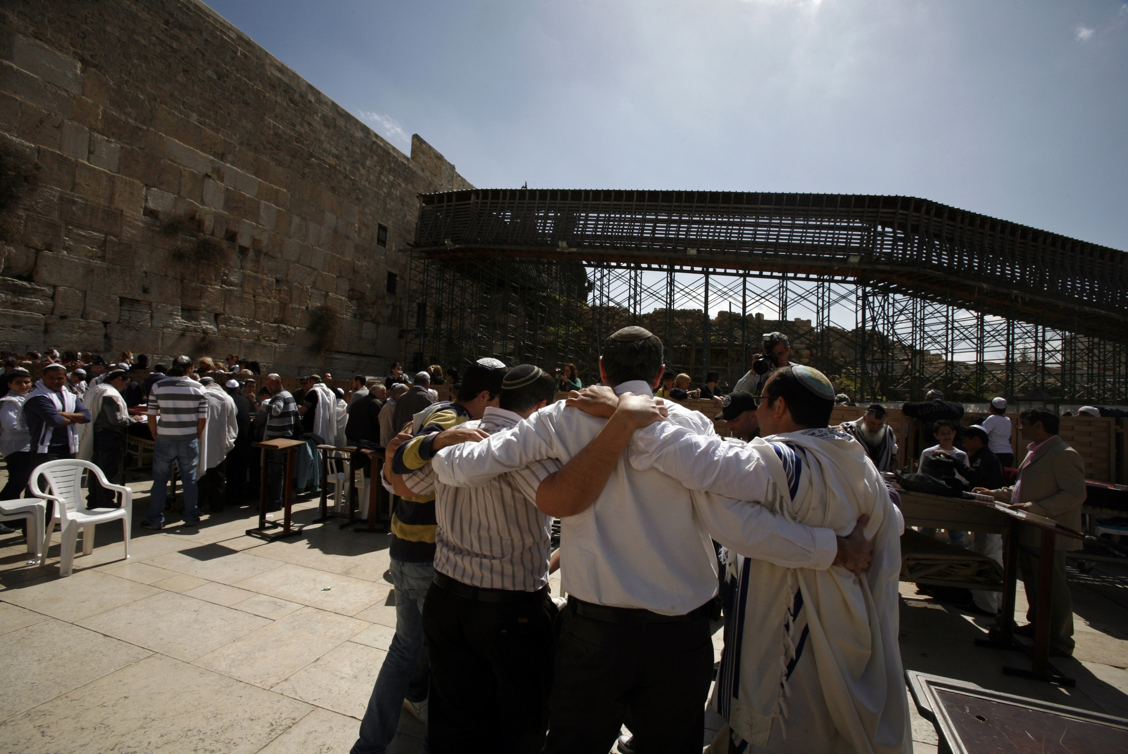 A group of men huddle and dance outside Jerusalem's Western Wall.