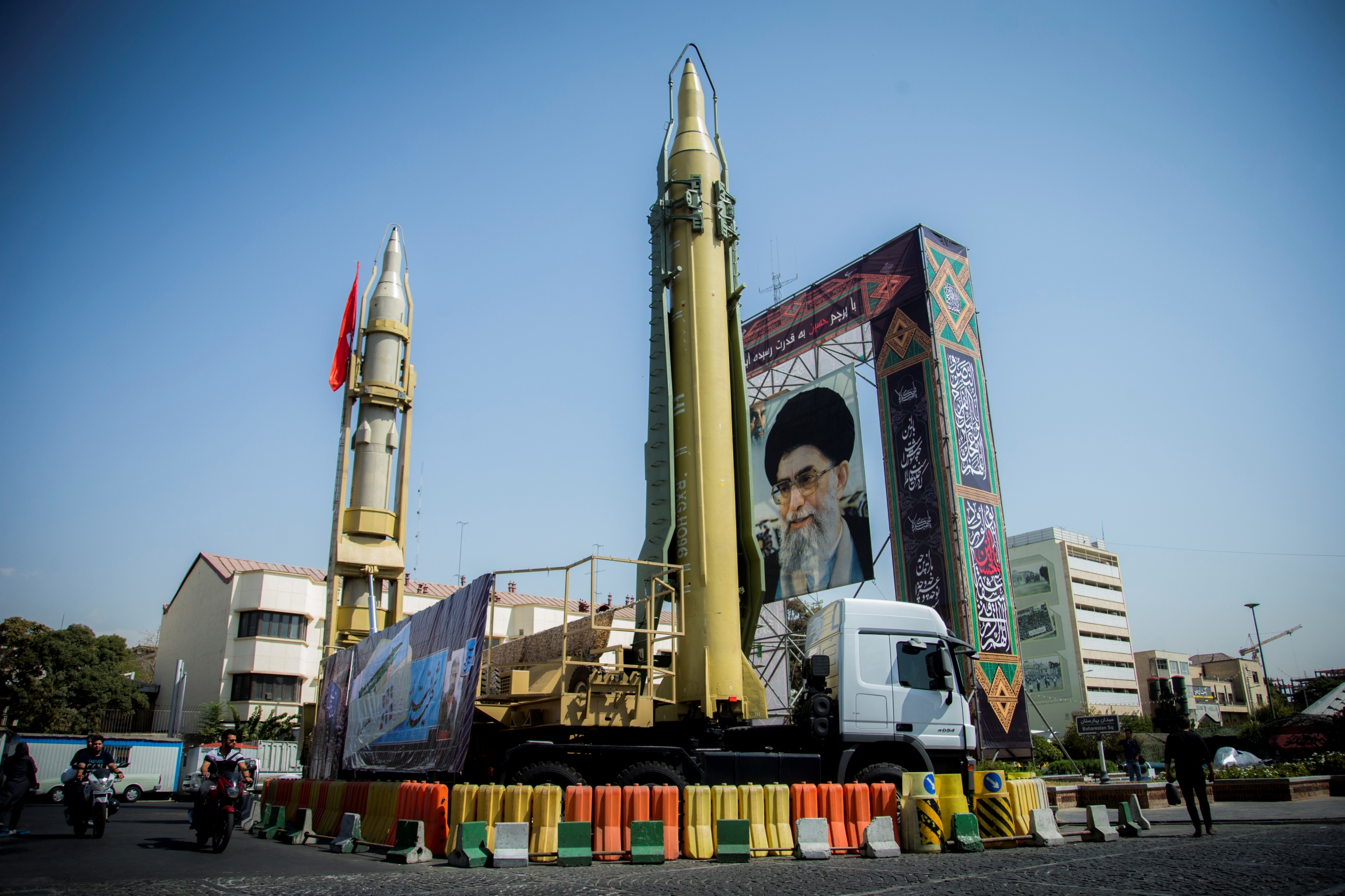 A display in an Tehran shows a portrait of Ayatollah Khamenei and two missiles.