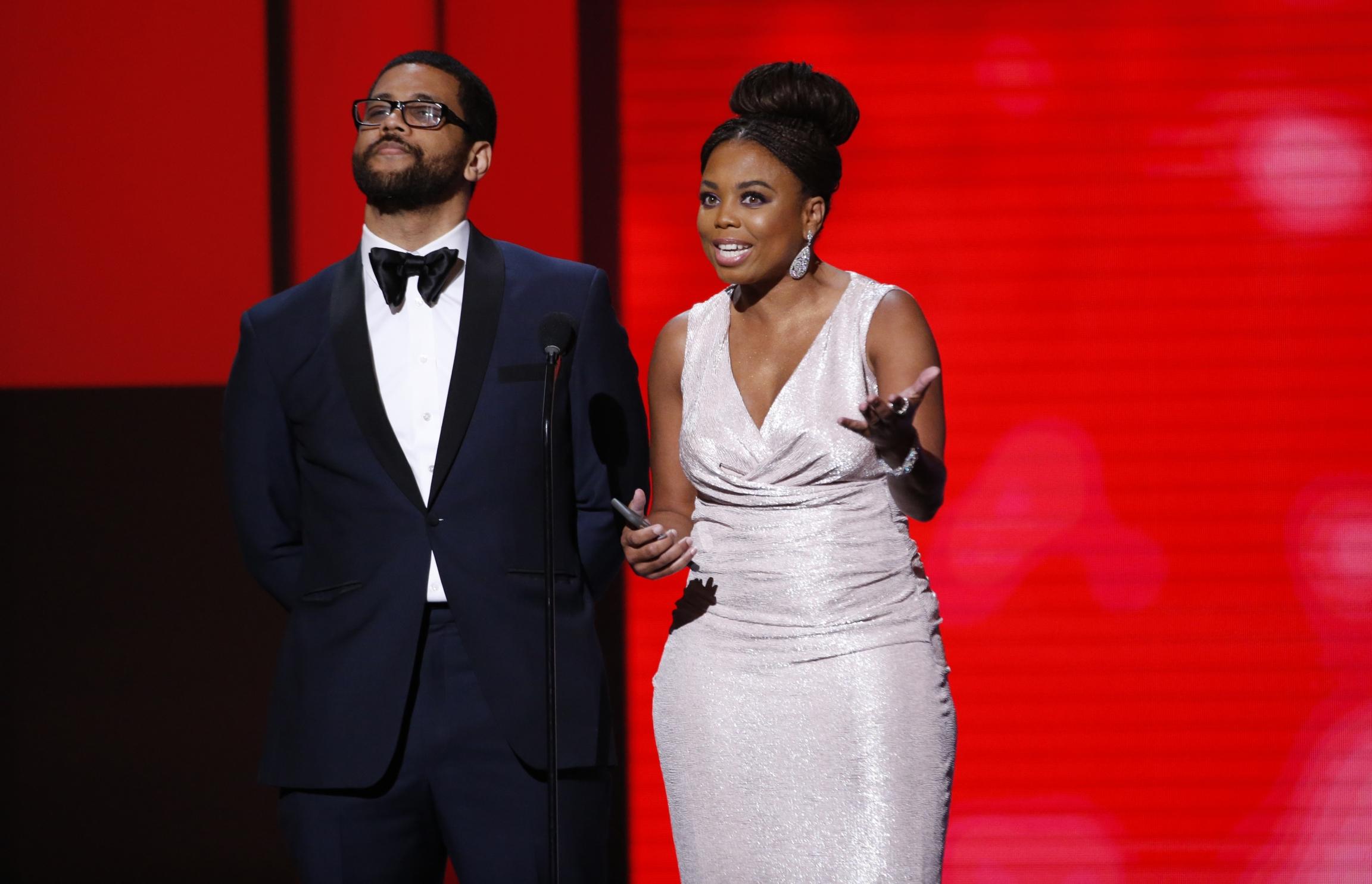 PresentersJemeleHilland Michael Smith speak on stage at 49th NAACP Image Awards.