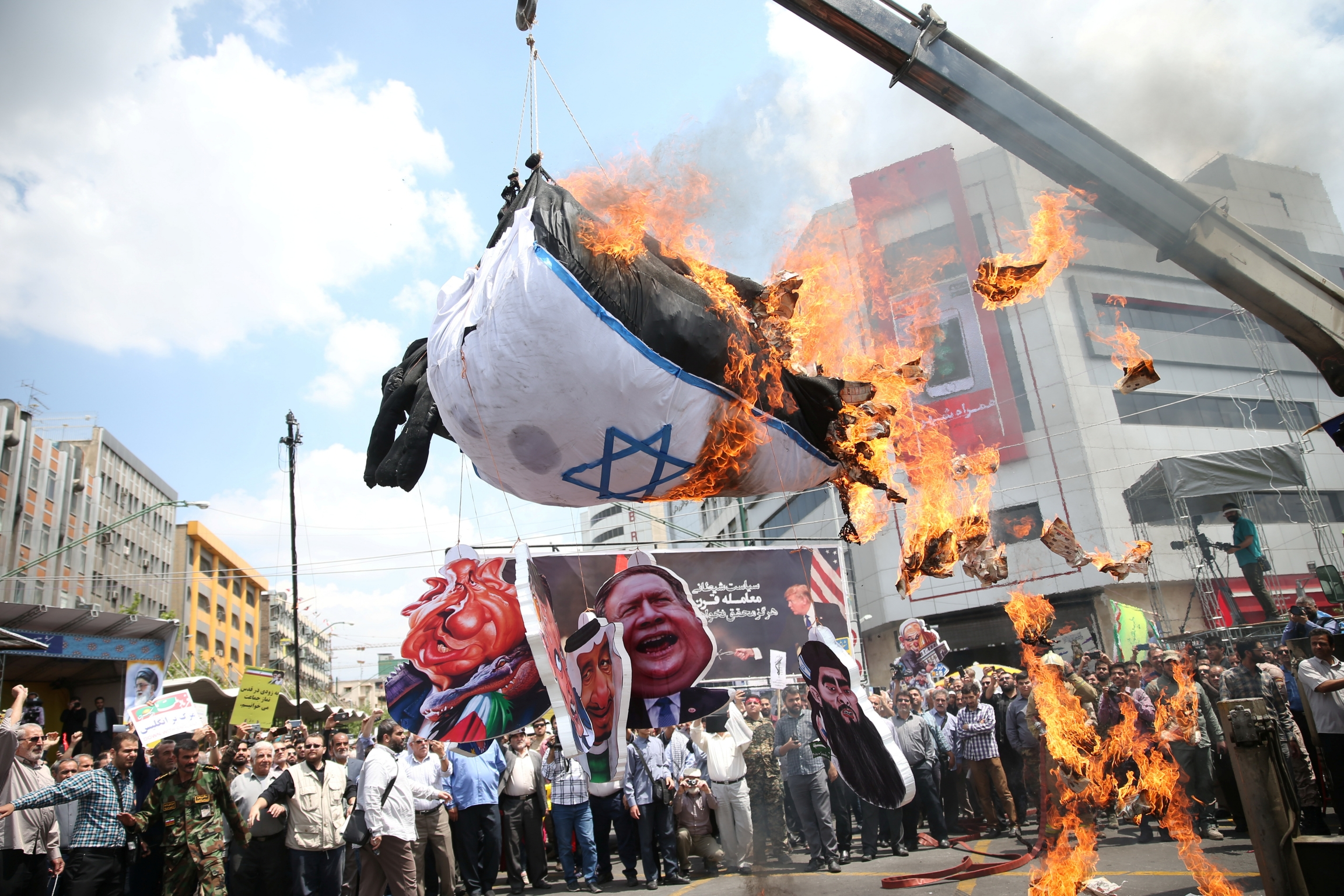 Iranians burn an Israeli flag during a protest marking the annual al-Quds Day (Jerusalem Day) on the last Friday of the holy month of Ramadan in Tehran, Iran May 31, 2019.