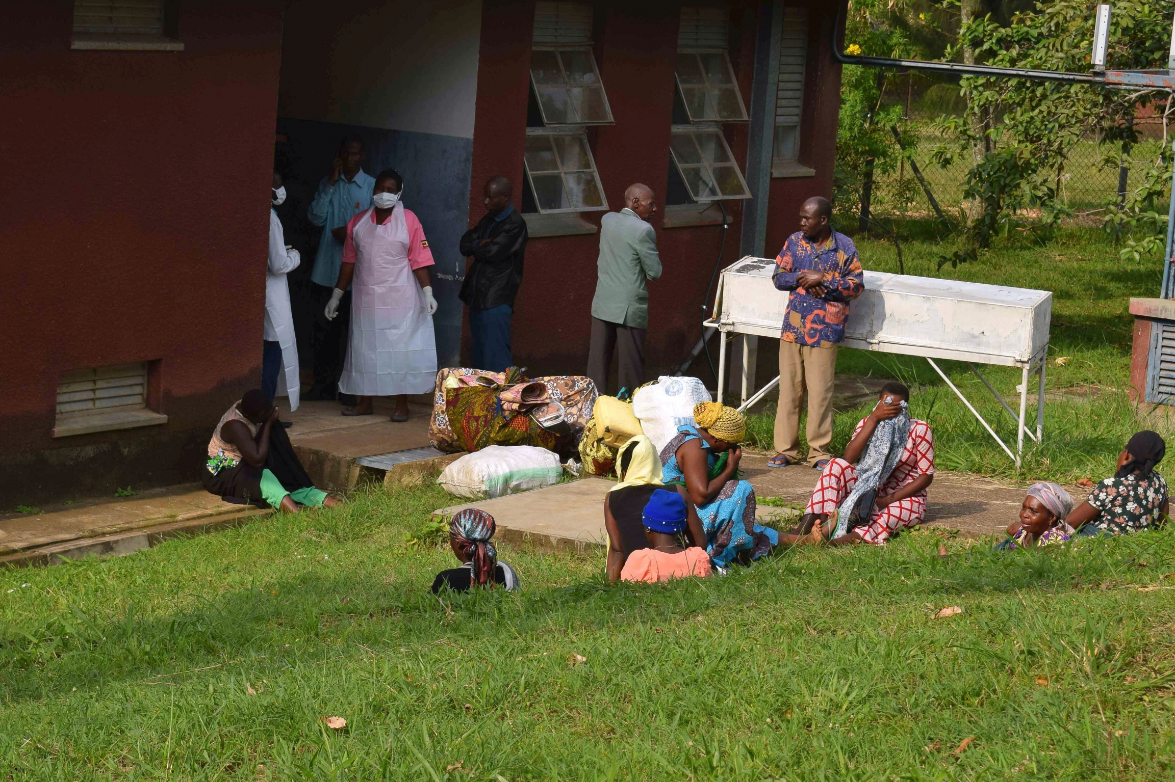 Bwera hospital medical staff stand outside prepping for Ebola patients.