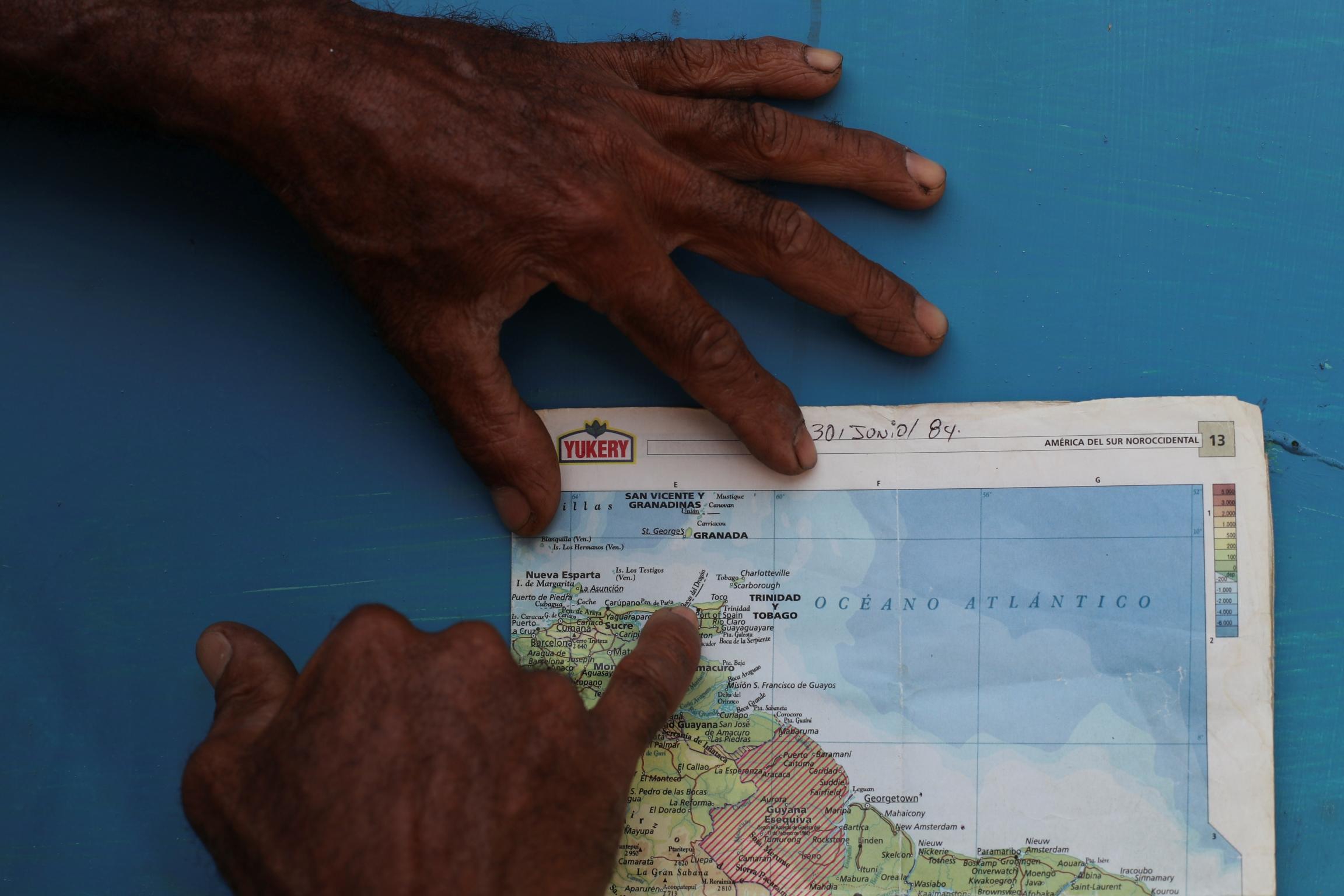 a man points out a dangerous sea passage on a map